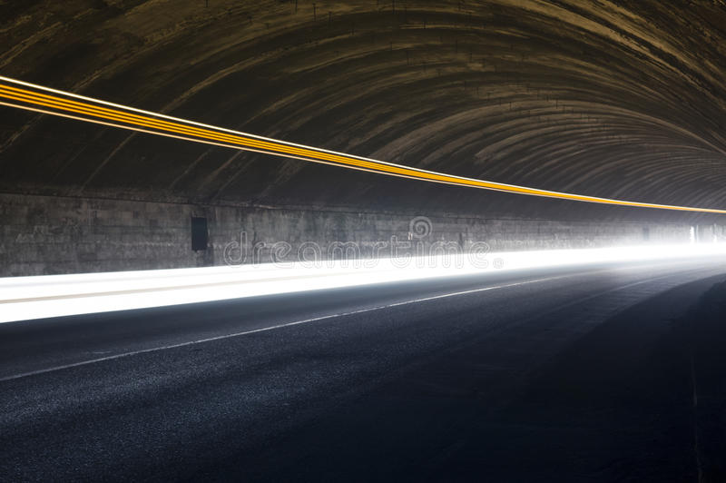 Interesting and abstract lights in orange, red, yellow and white. In a car tunnel that can be used as background or texture stock photos