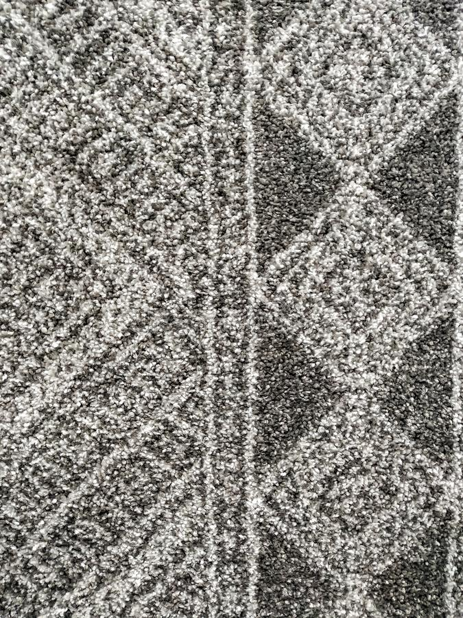 Interesting abstract modern design pattern of woolen and cotton carpet rugs with fluffy and warm texture for interior home. Flooring material royalty free stock photos