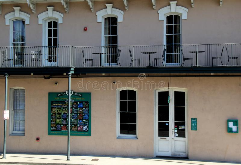 Interesting architecture and patios with railings, New Orleans, 2016. Interesting architecture with menu board for restaurants, and railings at edge of patios royalty free stock photos