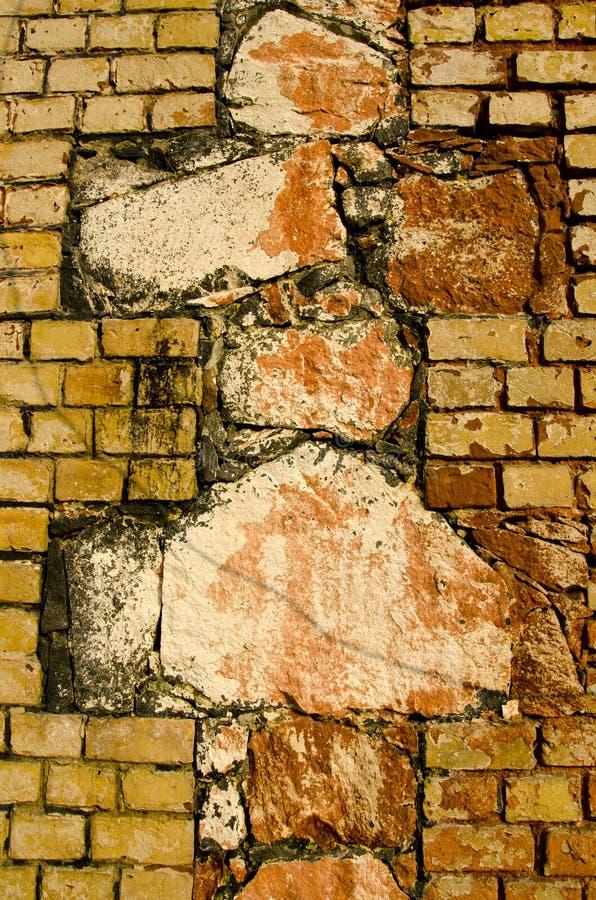 Interesting architecture wall of bricks cross sign. Architectural old wall background. Interesting architecture made of different bricks. Cross sign stock photography