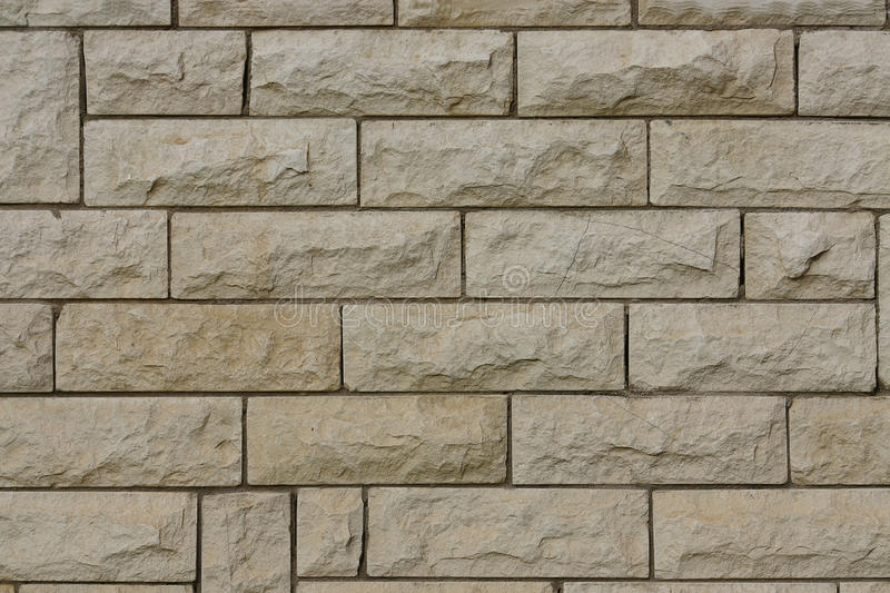 Interesting background. This interesting background represents the wall of a building combined from stones royalty free stock images
