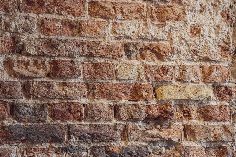 Interesting interesting background wall of old red bricks with gray mortar. Beautiful interesting interesting background wall of old red bricks with gray mortar stock photo