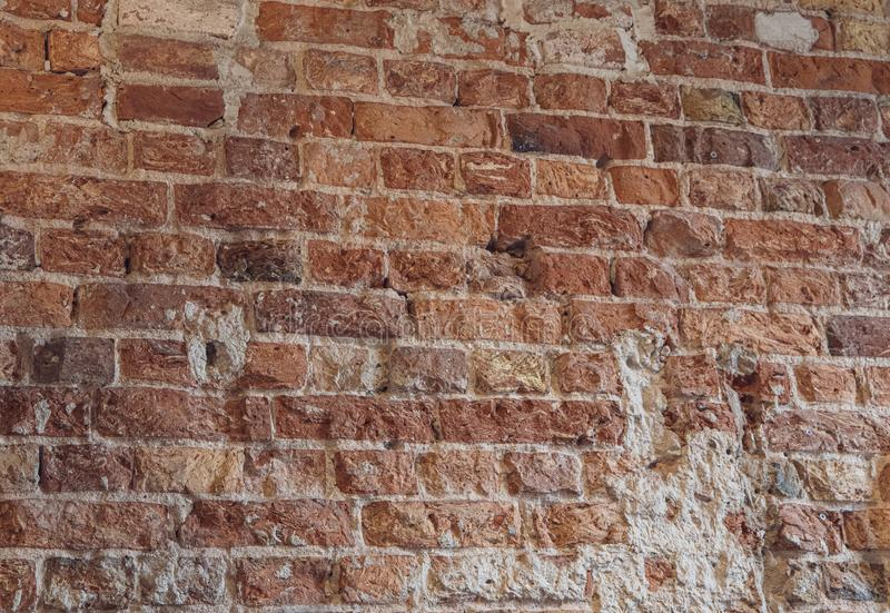 Interesting interesting background wall of old red bricks with gray mortar. Beautiful interesting interesting background wall of old red bricks with gray mortar royalty free stock photos