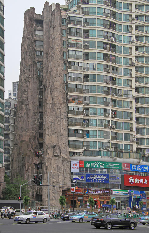 Interesting building united with cliff in Shanghai. Shanghai, China - July 2, 2015: interesting building united with cliff in Shanghai stock image