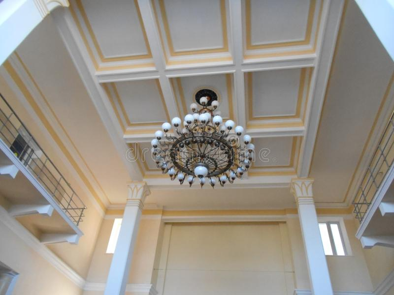 Interesting ceiling design and chandeliers. An unusual look and design of the architecture of the room with the decoration of the ceiling is not a standard royalty free stock photography