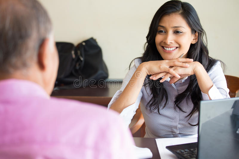 Interesting conversation. Closeup portrait, appointment with office manager, job interview, hiring, indoors office background. Getting that first job or stock photography