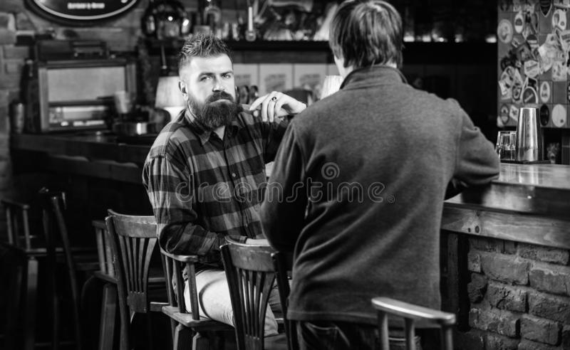 Interesting conversation. Men relaxing at bar. Friendship and leisure. Friday relaxation in bar. Friends relaxing in bar. Or pub. Hipster brutal bearded men stock images