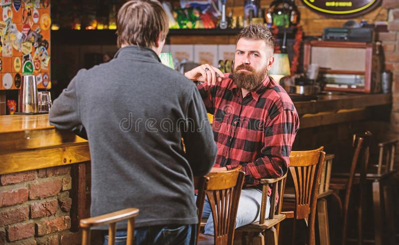 Interesting conversation. Men relaxing at bar. Friendship and leisure. Friday relaxation in bar. Friends relaxing in bar. Or pub. Hipster brutal bearded men stock photography