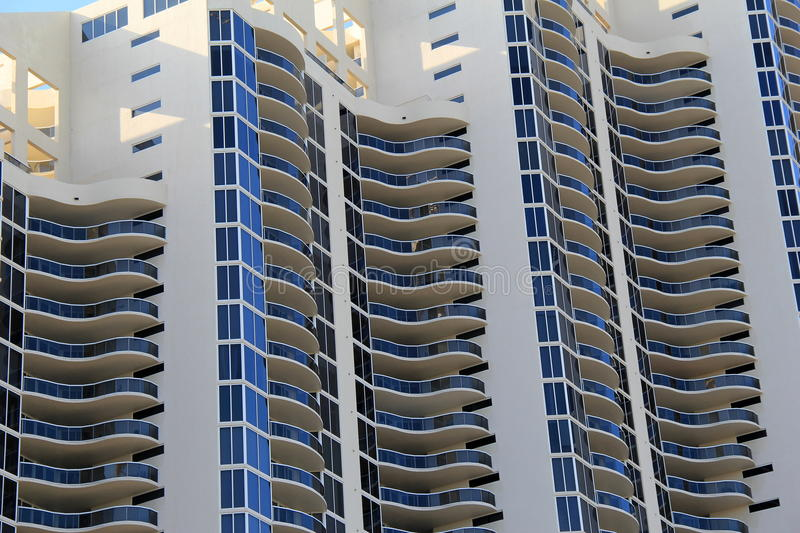 Interesting curve of contemporary architecture. Interesting curves of contemporary architecture in condominiums on busy city block royalty free stock photos