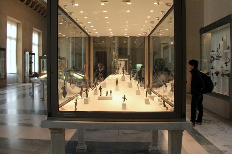 Interesting displays with Greek artifact exhibit,The Louvre,Paris,France,2016. Beautiful displays with interesting Greek artifacts, seen by visitors passing royalty free stock photography
