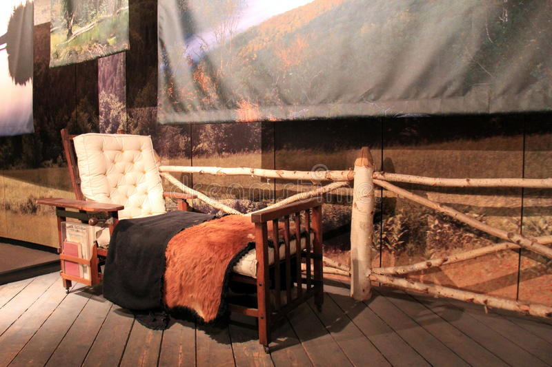 Interesting exhibit of early American furniture used by people in the Adirondacks, State Museum, Albany, New York, 2016. Interesting combination of chair and bed royalty free stock photos