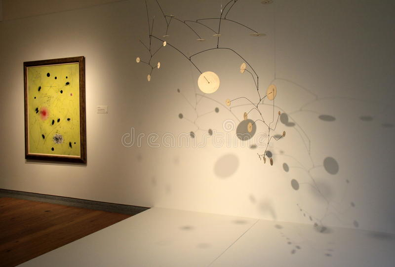 Interesting exhibit in one of many rooms, Portland Art Museum, Maine,2016. Interesting abstract art highlighted under soft lighting in one of many rooms royalty free stock image