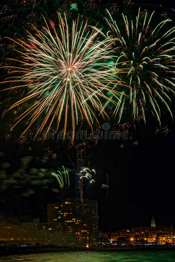 Interesting fireworks over the small town in Spain, Palamos stock photo