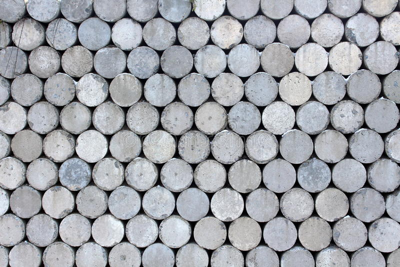 Interesting gray cylinder wall. Interesting and unique gray cylinder wall makes an interesting patterned and textured background royalty free stock images