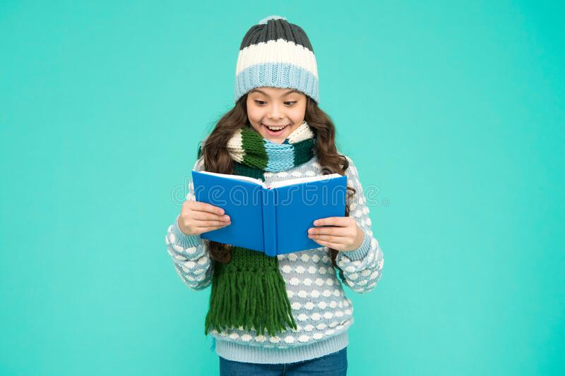 Interesting information. Library concept. Reading skills. Winter story. Girl reading book. Kid enjoying book. Little. Book lover. My favorite story. Leisure in royalty free stock photo