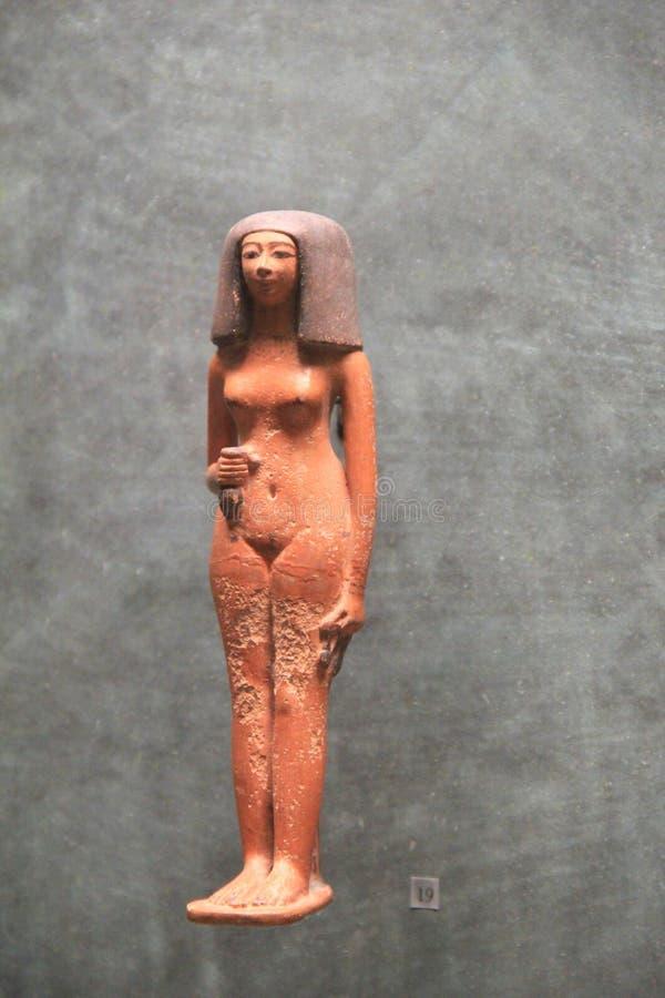 Interesting item in Extensive Egyptian exhibit, The Louvre, Paris, France, 2016. Interesting sculpture of woman in extensive Egyptian exhibit, The Louvre, Paris stock image