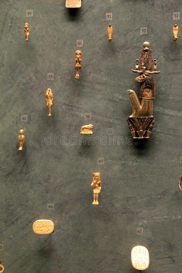 Interesting items recovered through excavation, in Extensive Egyptian exhibit, The Louvre, Paris, France, 2016. Interesting metal pieces recovered through stock photo