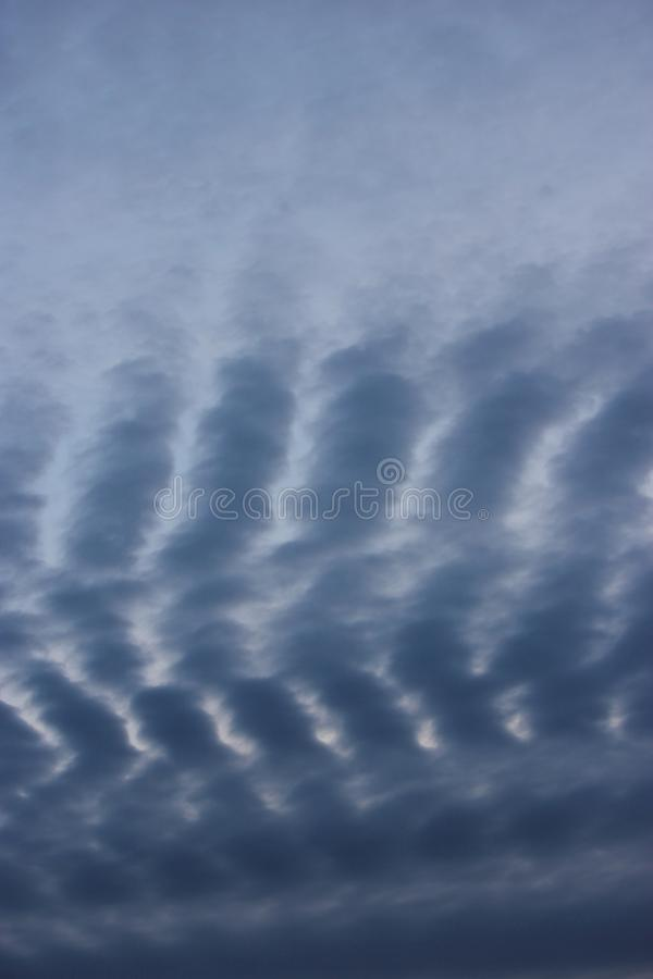 Vertical Abstract Weather Natural Blue Grey wave cloud pattern sky background Nature. Interesting natural cloudy sky weather abstract patterned sky background royalty free stock image
