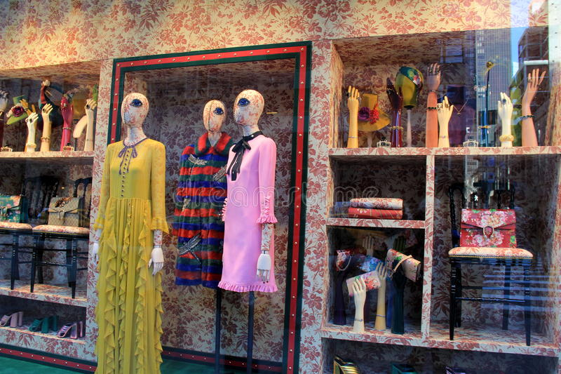 Interesting and odd window dressing of one-eyed mannequins and accessories,NYC,2015. Oddly interesting window dressing of one-eyed mannequins with shelves of stock images