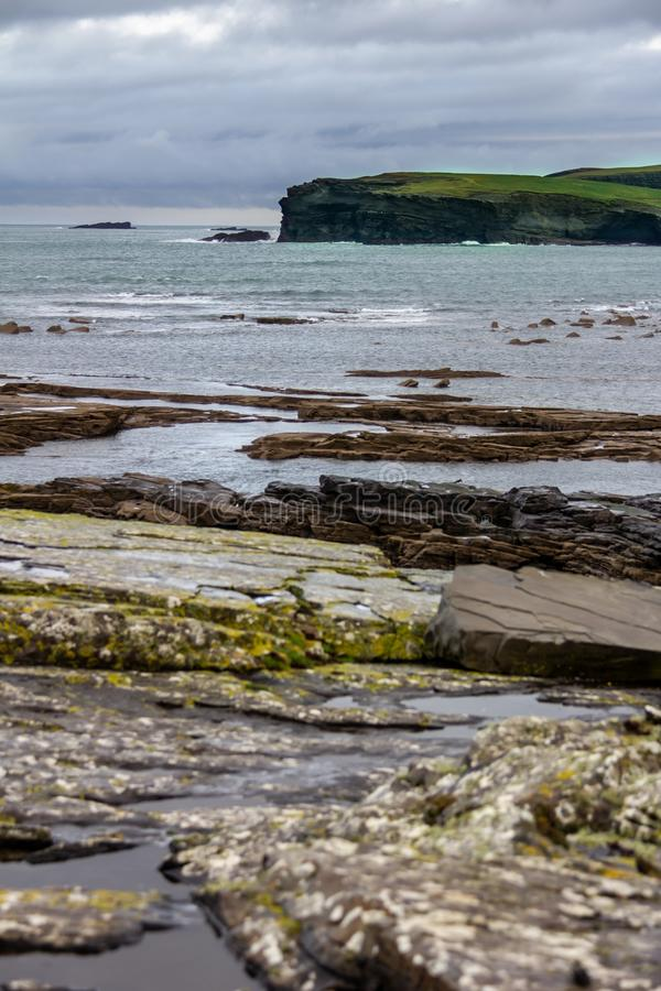 Interesting rock formations at the cliffs surrounding Kilkee, Ireland. Surrounding the seaside town of Kilkee, County Clare, Ireland are interesting cliffs with royalty free stock image