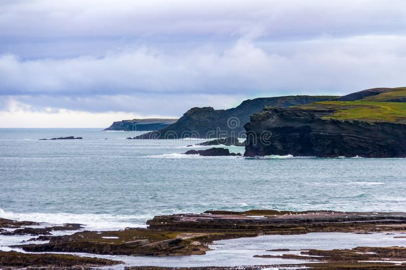 Interesting rock formations at the cliffs surrounding Kilkee, Ireland. Surrounding the seaside town of Kilkee, County Clare, Ireland are interesting cliffs with royalty free stock photos