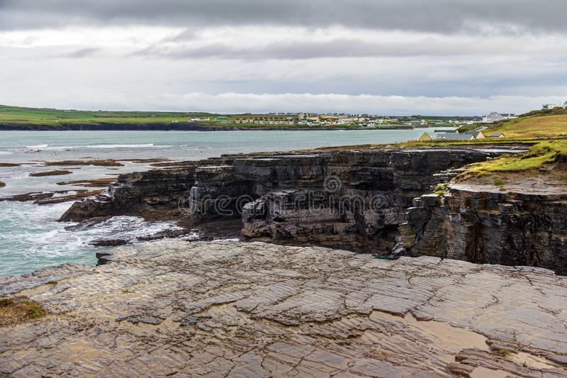 Interesting rock formations at the cliffs surrounding Kilkee, Ireland. Surrounding the seaside town of Kilkee, County Clare, Ireland are interesting cliffs with royalty free stock images