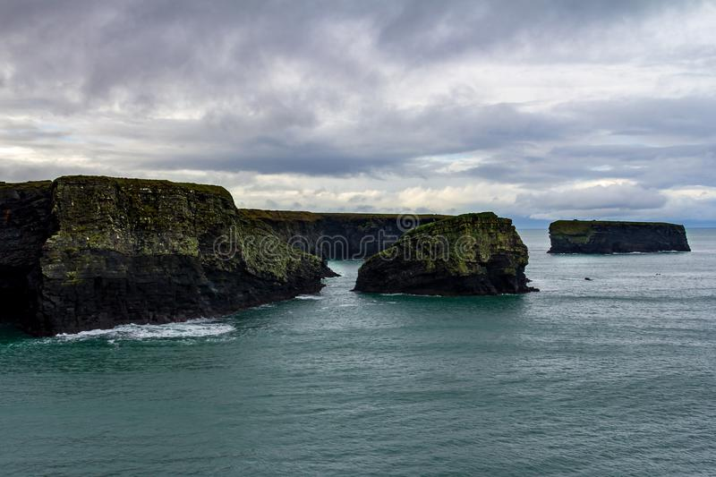 Interesting rock formations at the cliffs surrounding Kilkee, Ireland. Surrounding the seaside town of Kilkee, County Clare, Ireland are interesting cliffs with royalty free stock photo