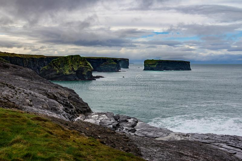 Interesting rock formations at the cliffs surrounding Kilkee, Ireland. Surrounding the seaside town of Kilkee, County Clare, Ireland are interesting cliffs with stock photos