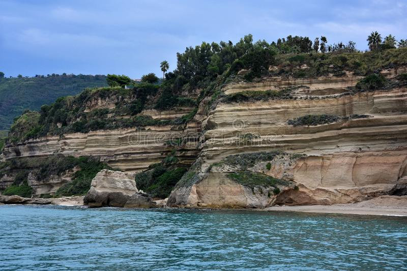 Interesting rock formations at the coast between Tropea and Capo Vaticano. The rocky coast between Tropea and Capo Vaticano looks like folded. The sandstone royalty free stock photo