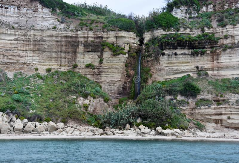 Interesting rock formations at the coast between Tropea and Capo Vaticano. The rocky coast between Tropea and Capo Vaticano looks like folded. The sandstone stock photography