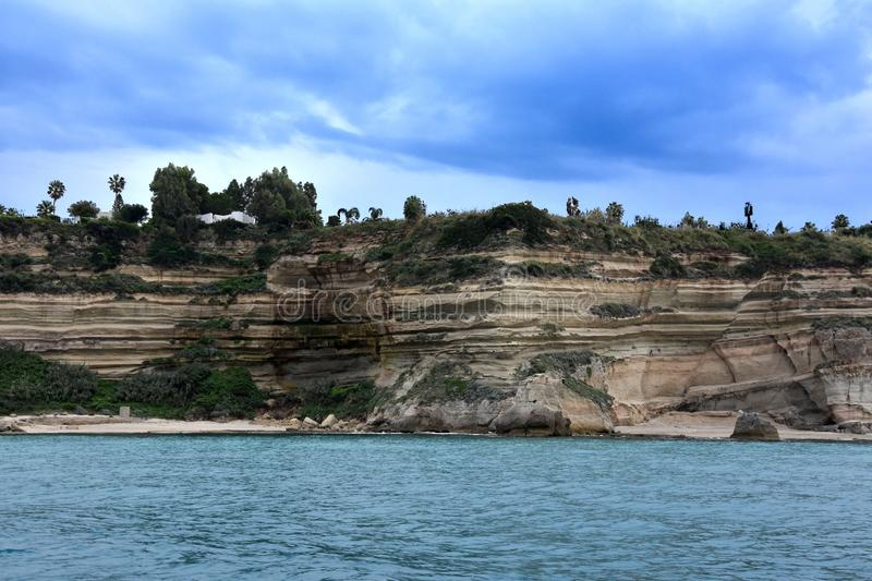 Interesting rock formations at the coast between Tropea and Capo Vaticano. The rocky coast between Tropea and Capo Vaticano looks like folded. The sandstone royalty free stock image