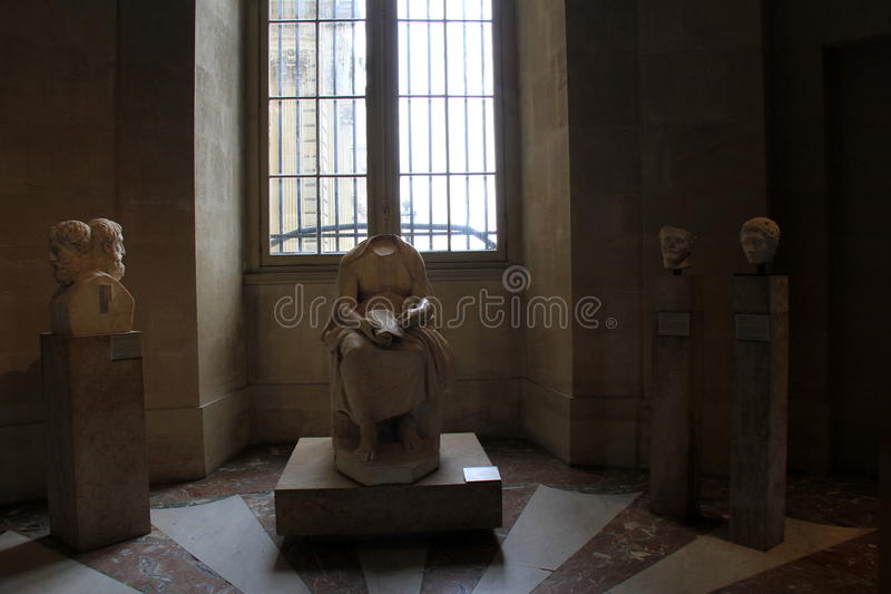 Interesting sculptures set on pedestals, seen in one of many exhibits, The Louvre, Paris, France, 2016. Interesting sculptures set on several pedestals,seen in stock photo