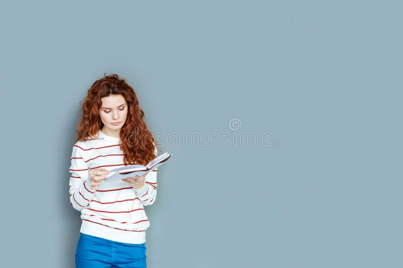 Pleasant smart woman reading a book royalty free stock photo