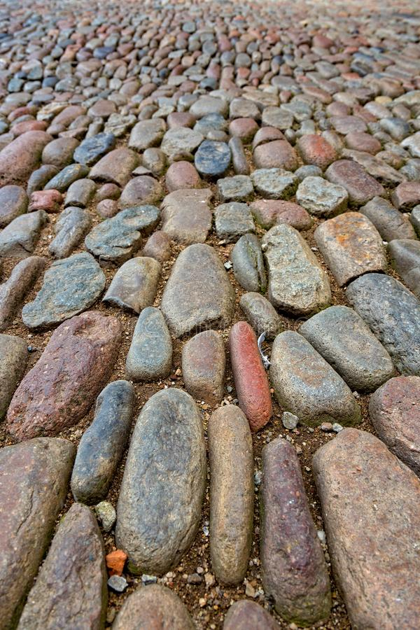 Interesting street detail with pebble stones royalty free stock photo