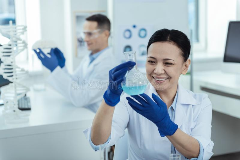 Cheerful researcher making a test in the lab royalty free stock image