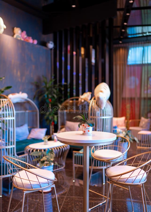Interesting and trendy cafe with colourful lighting interior.  royalty free stock photography