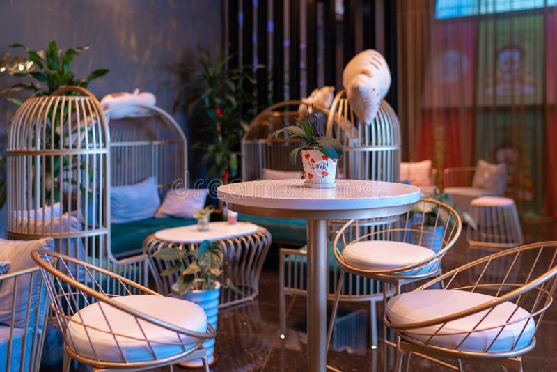 Interesting and trendy cafe with colourful lighting interior.  stock image