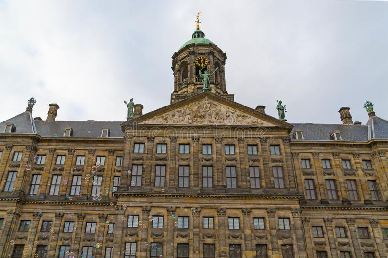 Interesting view of top part of The Royal Palace in Dam Square with bubble blower, Amsterdam, Netherlands royalty free stock images
