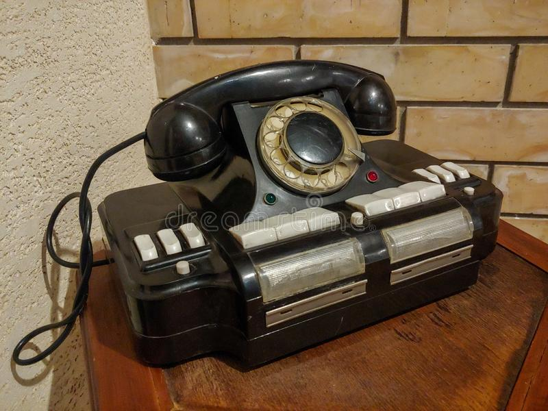 An interesting, vintage dial telephone, like a design room. Ninteresting, vintage, dial telephone, as a design room and for your creativity royalty free stock photography