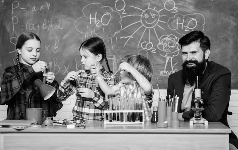 Interests and topic club. Share interests hobbies talents and skills. School club education. Teacher and pupils test. Tubes in classroom. Chemistry themed club royalty free stock image