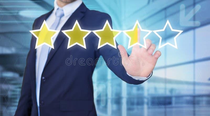 Interface émouvante de technologie d'homme d'affaires avec des étoiles de rang photo stock