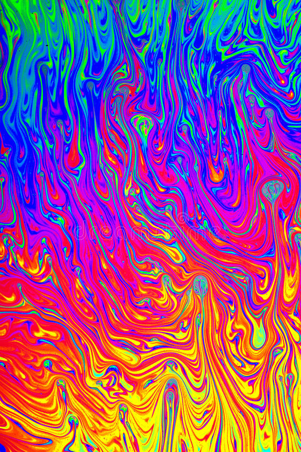 Interference. Causes this pattern on a thin film of fluid, which is used to make soap-bubbles, seen through polarized light royalty free stock image