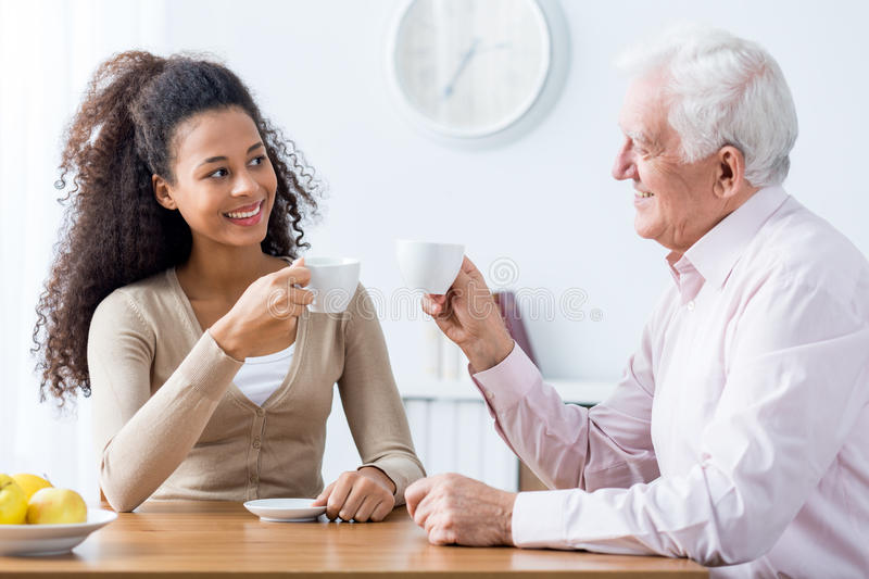 Intergenerational discussion with cup of coffee stock photos
