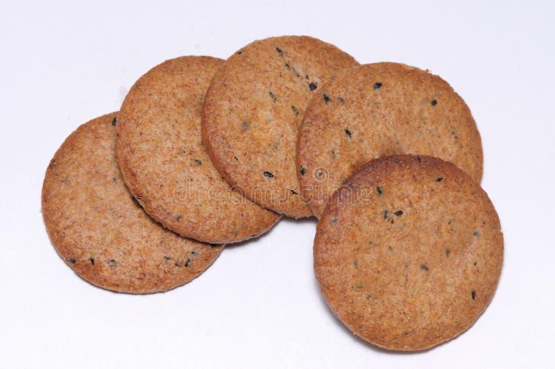 Interi biscotti della farina di frumento dei grani fotografia stock