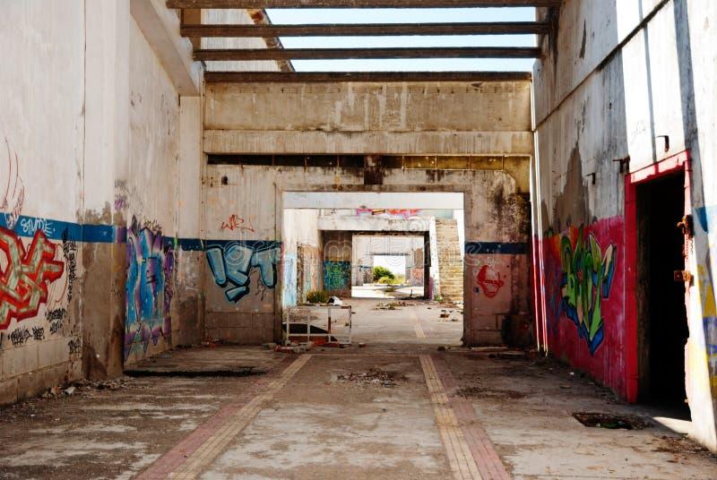 Interior of abandoned factory. Building, full of graffiti royalty free stock photos