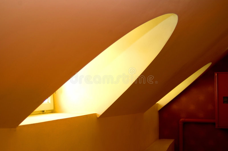 Interior abstract. Curved roof windows in this interior abstract background stock image