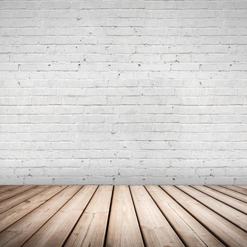 Interior abstrato. Assoalho de madeira e parede branca imagem de stock royalty free