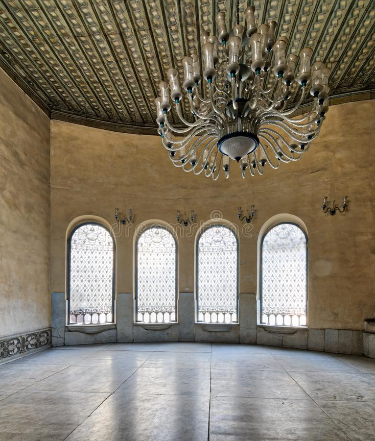 Interior of Agha El-Selehdar Sabil with iron ornate windows, white marble floor, and huge chandelier, Cairo, Egypt stock photography