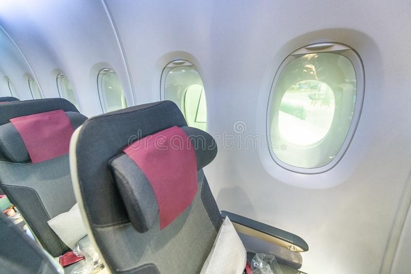 Interior of airplane with seats and windows royalty free stock photos