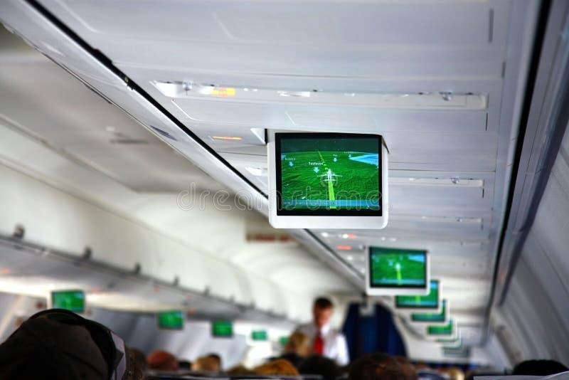 Interior of airplane with telescreens. Interior of passanger airplane with telescreens stock image